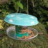 Bird Feeder Out Of Recycled Materials photos