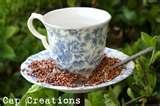 photos of Tea Cup Bird Feeder Tutorial
